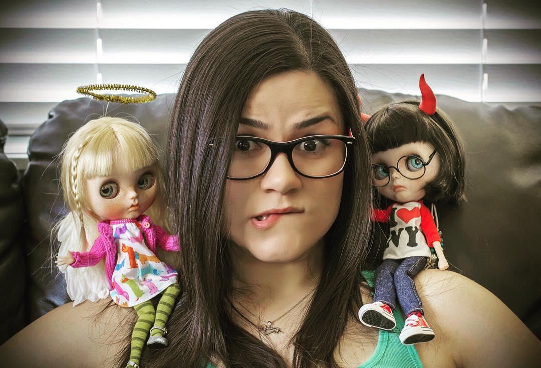 Mayra Galland between two of her custom Blythe dolls